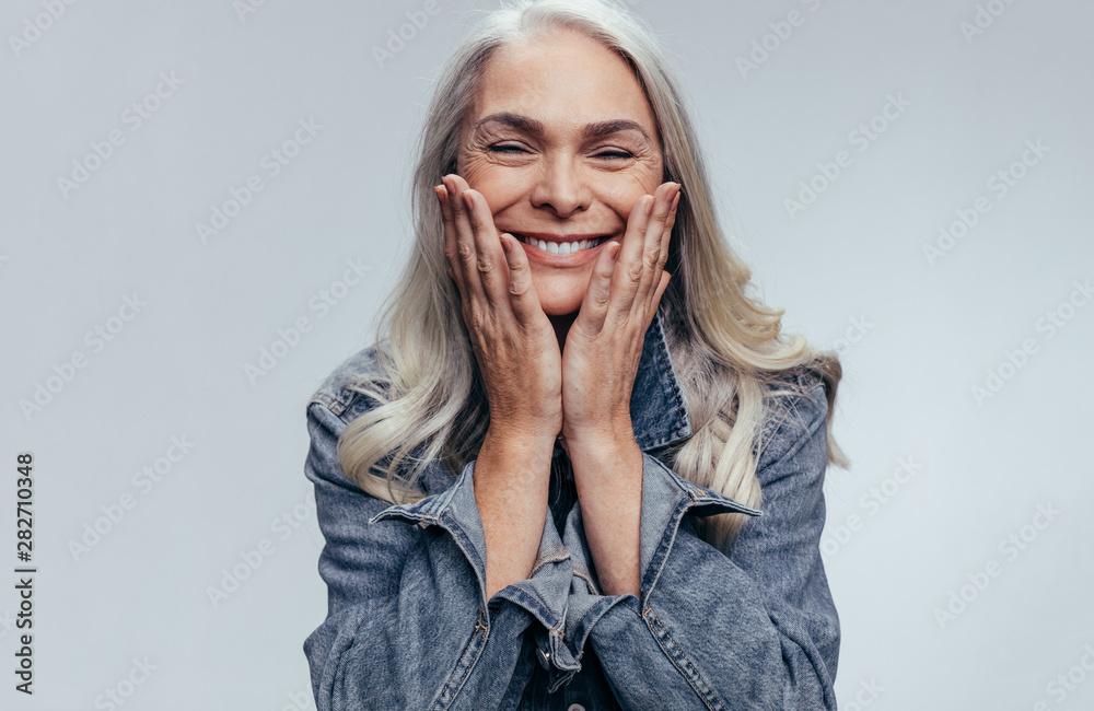 Fototapeta Cheerful senior woman