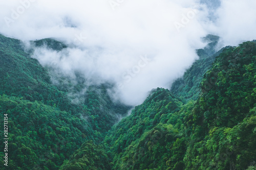 Foto auf AluDibond Blau türkis Mountain ridges in clouds, Mingyue Mountain, China
