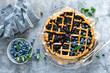 canvas print picture - Traditional homemade american blueberry pie with lattice pastry, top view.