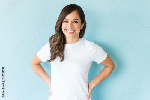 Stampa su Tela  Happy Woman Against Blue Background