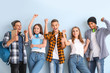Portrait of happy young students on color background