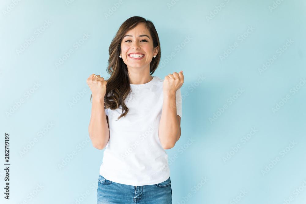 Fototapeta Cheerful Woman Having Fun In Studio