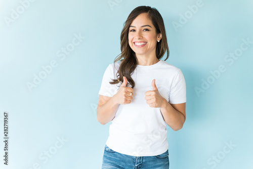 Woman Giving Thumbs Up Over Plain Background Canvas Print