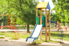 Blurred View Of Playground In Park