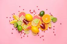 Different Sliced Citrus Fruits On Color Background