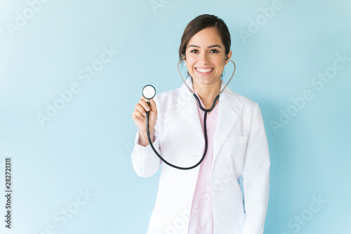 Canvastavla  Female Doctor With Stethoscope On Isolated Background