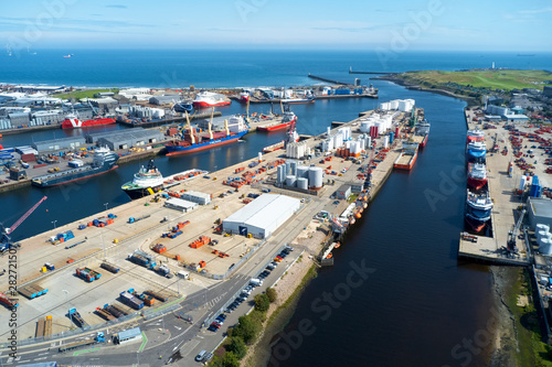 Canvas Print Aerial view of Aberdeen harbour ships with oil & gas tanks and sea vessels