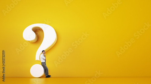 Valokuva Man leaning on a big white question mark on a yellow background