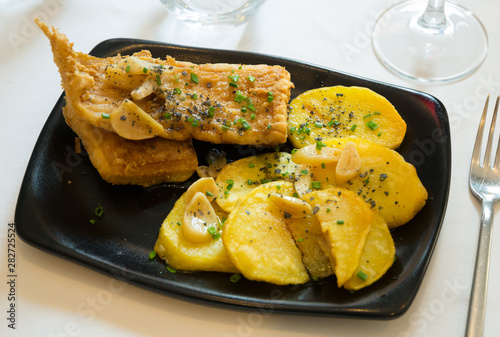 Roasted ray wings with potatoes