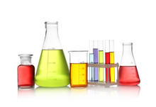 Set Of Lab Glassware With Color Liquids Isolated On White. Solution Chemistry