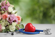 Composition With Red Heart And Stethoscope On White Table Against Blurred Background. World Health Day