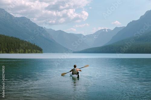 Slika na platnu Kayaker in Mountains