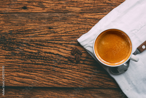 Coffee cup and beans on old wood table. espresso Canvas Print