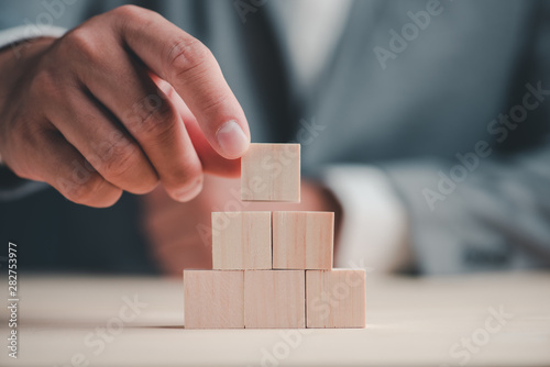 hand stack woods block step on table. business development concept.copy space.