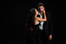 Passionate Girl In Dress Touching Handsome Bearded Man Isolated On Black