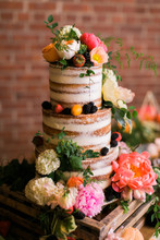 Modern Naked Wedding Cake With Colorful Summer Flowers, Pink And Orange Flowers On Wedding Cake Table