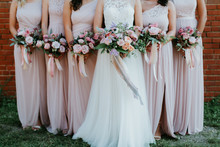 Bride And Bridesmaids Holding ...