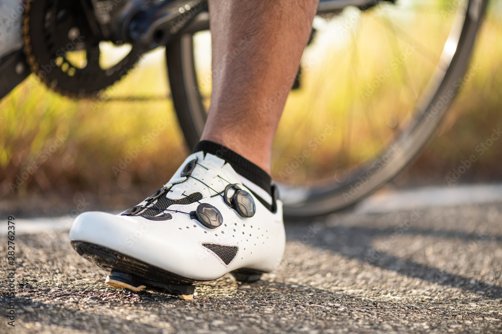 Fototapety, obrazy: Close up bike shoes ready for cycling outdoors. Sports and outdoor activities concept.