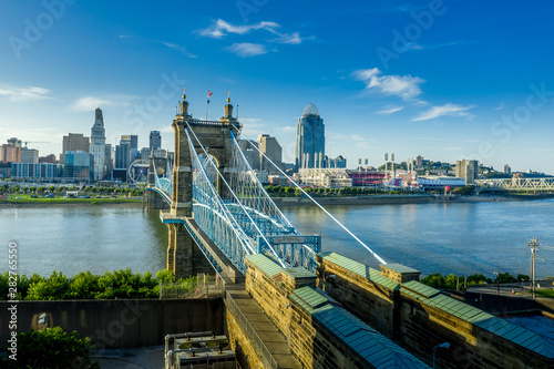 Fototapety, obrazy: Panoramic view of Cincinnati downtown with the historic Roebling suspension bridge over the Ohio river