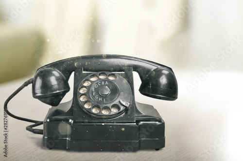 Retro black telephone on background