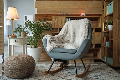 Cozy rocking chair in interior of living room