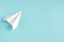 White Paper Plane On Blue Background Composition.