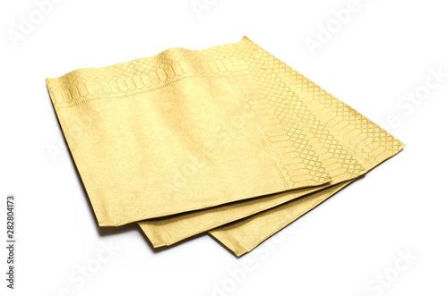 Fotografie, Obraz  Golden paper napkin isolated on white background