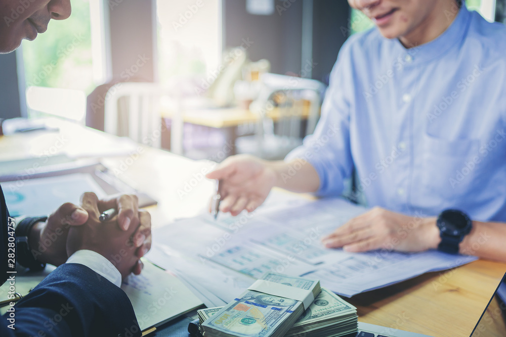 Fototapeta Loan business finance businessman explain business report from data analysis or bank marketing for loan money. Selected focus.
