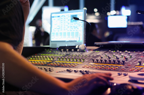 Fototapeta  close ups on sound engineer with studio sound and visual mixer used for media an