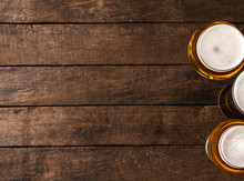 Beer Glasses On Wooden Table W...