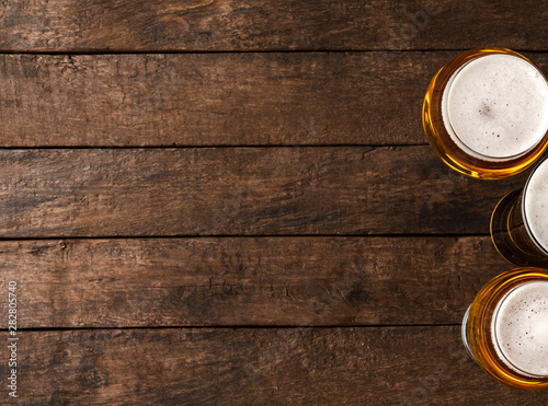 Beer glasses on wooden table with copyspace. Wallpaper Mural