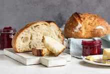 Toasted White Artisan Bread With Butter And Jam On Light Grey Stone Table. Simple Breakfast.