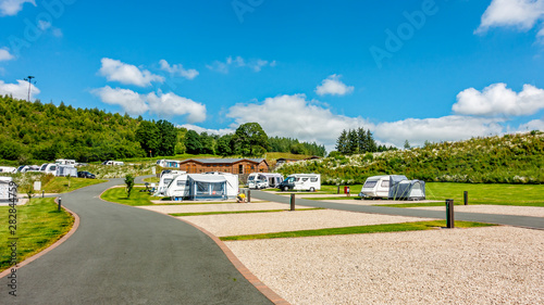 Obraz Red Kite Campsite, Llanidloes, Wales. A campsite for touring caravans, motorhome and campervans exploring mid-Wales, UK - fototapety do salonu
