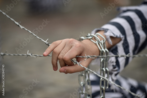 Prisoner grabbing a barbed wire fence Canvas-taulu