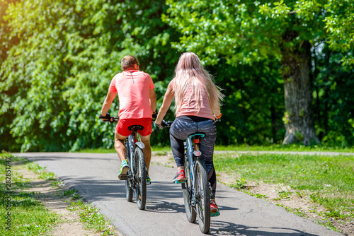 Vászonkép Cyclists ride on the bike path in the city Park