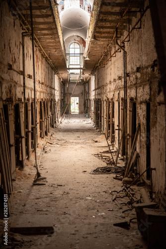 Prison corridor in disrepair Wallpaper Mural