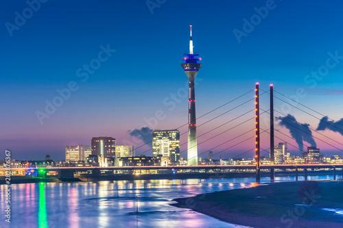 Fotografija  Rheinturm TV tower and Kniebrücke in Düsseldorf, Germany during the Blue Hour