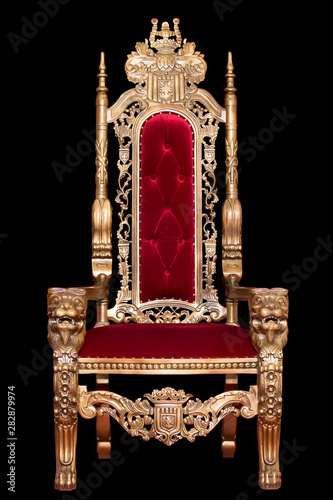 Fotomural Red royal chair isolated on black background