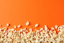 Flat Lay Composition With Popcorn On Orange Background, Copy Space