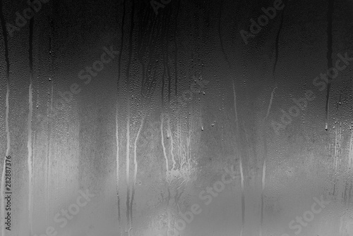 Real glass Window with steam and condensation on surface raining Night Canvas Print