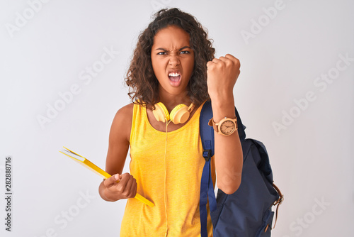 Photographie  Brazilian student woman wearing backpack holding notebook over isolated white ba