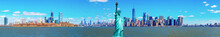 Panorama Of The Statue Of Liberty With The One World Trade Building Center Over Hudson River And New York Cityscape Background, Landmarks Of Lower Manhattan New York City.