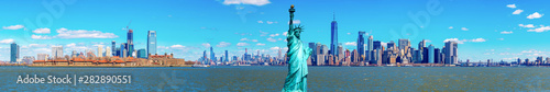 Panorama of The Statue of Liberty with the One world Trade building center over hudson river and New York cityscape background, Landmarks of lower manhattan New York city. - 282890551