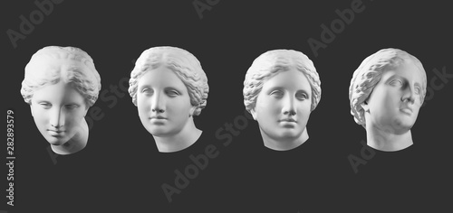 Stampa su Tela Four gypsum copy of ancient statue Venus head isolated on black background