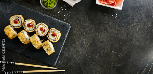 Foto auf AluDibond Lineale Wachstum Deep Fried Sushi Rolls with Salmon and Philadelphia Cream Cheese