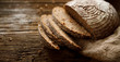 Leinwandbild Motiv Bread,  traditional spelled sourdough bread cut into slices on a rustic wooden background, close-up, top view, copy space. Concept of traditional leavened bread baking methods