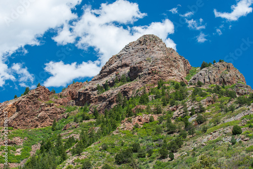 Low angle landscape of rock mountains and greenery on the Shelf Road near Cripple Creek, Colorado