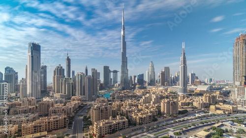 Fototapeta  Dubai Downtown skyline timelapse with Burj Khalifa and other towers paniramic vi