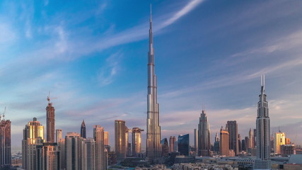 Dubai Downtown skyline timelapse with Burj Khalifa and other towers during sunrise paniramic view from the top in Dubai