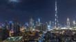 Dubai Downtown skyline during all night timelapse with Burj Khalifa and other towers paniramic view from the top in Dubai